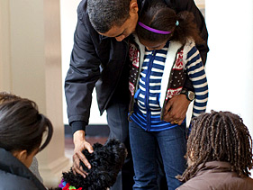 The Obamas welcoming their new dog