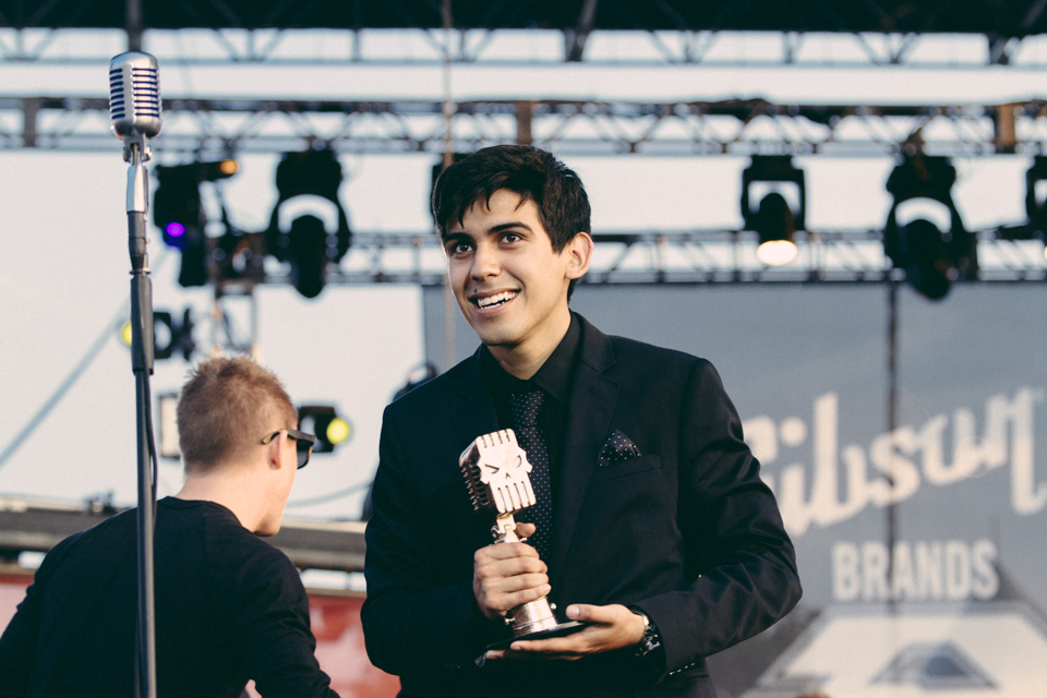 Andrew Velasquez of Crown The Empire accepting their Breakthrough Band award