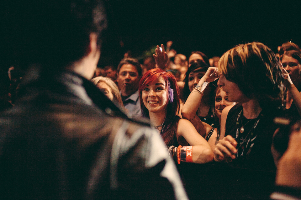 Andy Biersack of Black Veil Brides giving his Most Dedicated Fans award to a fan in the crowd