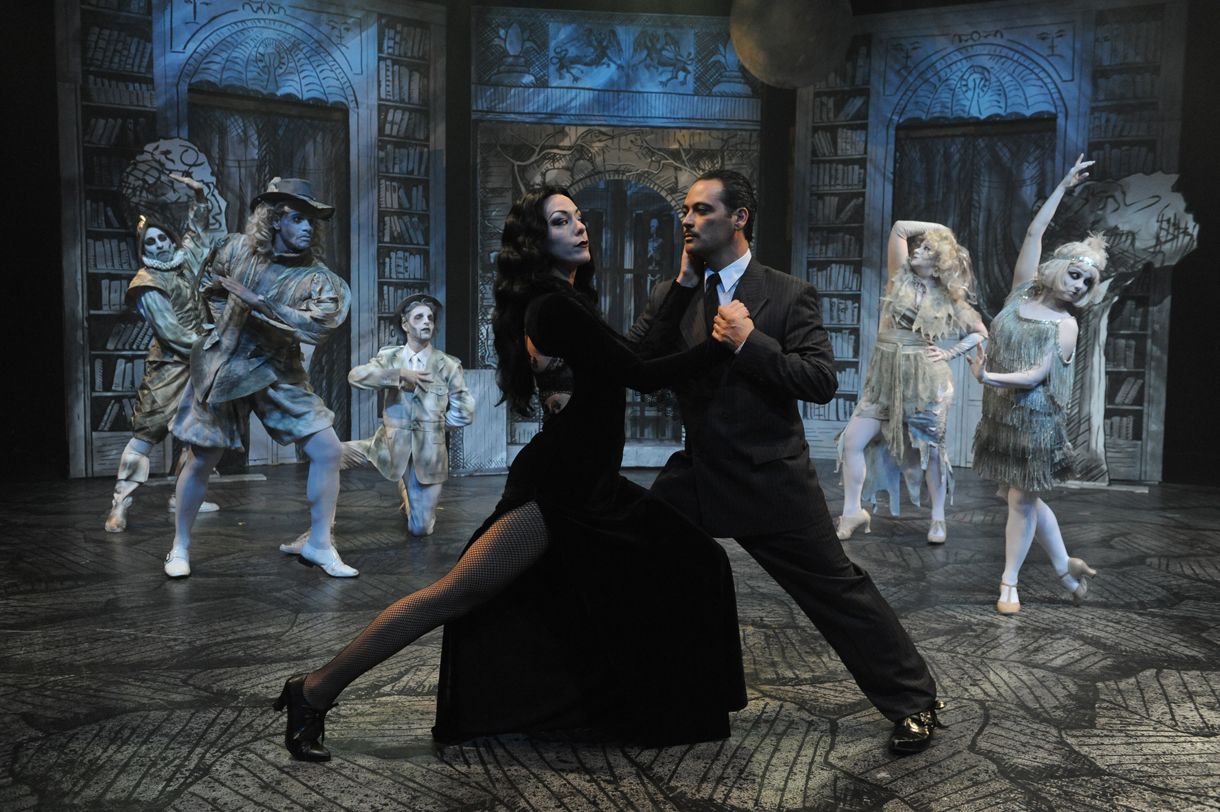 """Dave Lepori / San Jose Stage Allison F. Rich as Morticia, left, and Johnny Moreno as Gomez dance the """"Tango de Amor"""" with a little help from the ensemble in """"The Addams Family"""" at San Jose Stage, June 3 through July 26, 2015."""